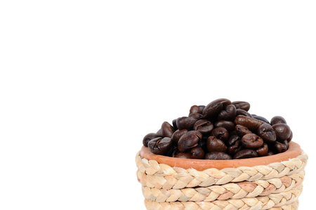contain: Clay pot with vintage rope contain many coffee seeds