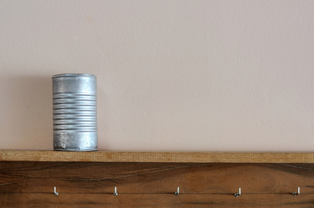 aluminum cans: Classic aluminum cans on wooden shelf Stock Photo