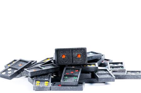dominoes: Dominoes lying on white table.