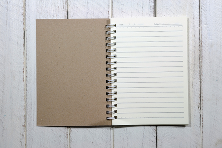 treatise: Note book on white wooden table