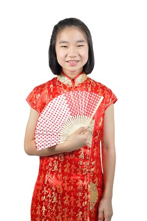 traditions: Asia female teenager wear red suit pose for Chinese New Year traditions