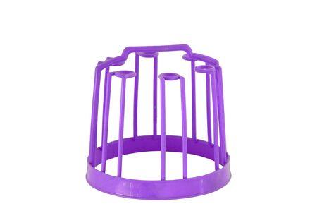 inverted: Purple plastic glasses inverted on white background. Stock Photo