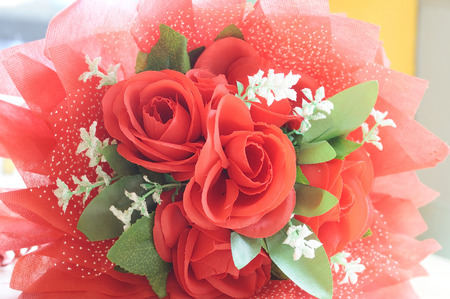 Artificial red roses bouquet for decoration Stock Photo