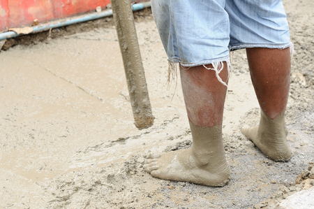 Worker pouring cement and adjust during Upgrade walkway