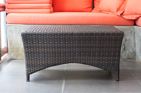 Brown rattan coffee table with sofa loft style