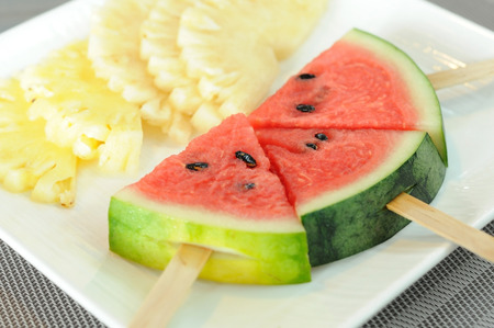Pineapple slices with watermelon sticks Stock Photo