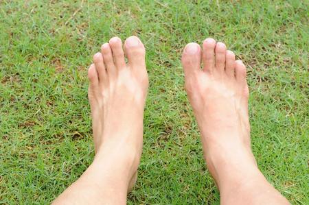 Man legs relaxation on green grass