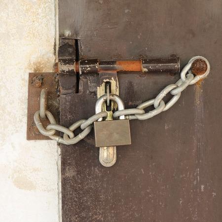 Brown steel door with padlock, Locked. Stock Photo