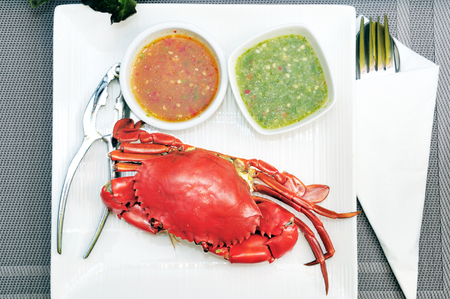 Sea crab spicy sauces set with crab claw Stock Photo
