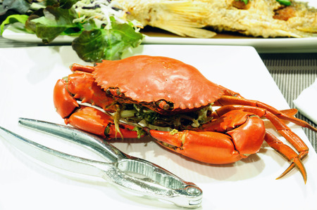 Sea crab and snapper seafood set with spicy sauce Stock Photo