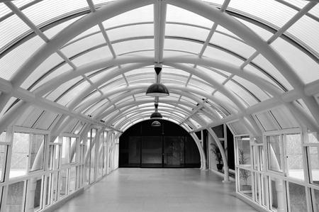 between: Corridor connect between buildings in monochrome Stock Photo