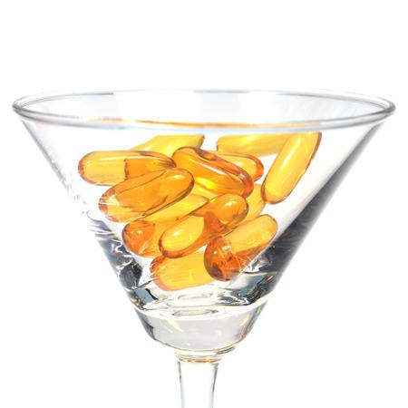 capsules: Cod liver oil capsules in martini glass
