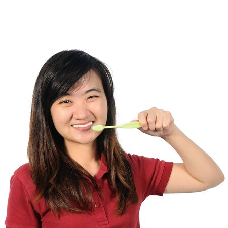 oral health: Asian middle woman 30 years old brushing her teeth, Oral health conception