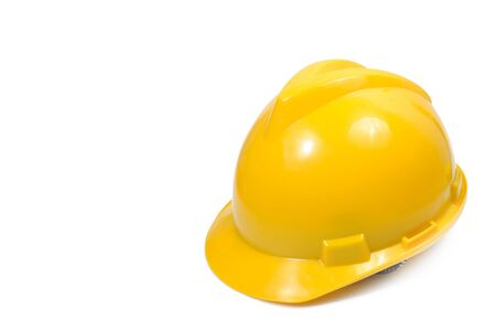 Yellow safety engineer helmet  on white background, clipping path included. Banco de Imagens