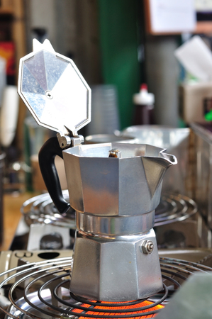 boiling: Classic Italian coffee pot boiling on stove