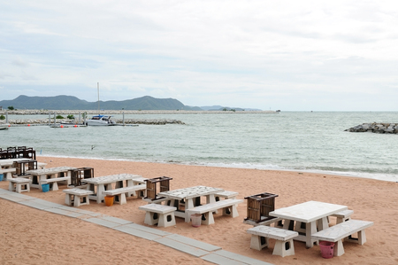 airlie: Dining tables located on sand beach by sea