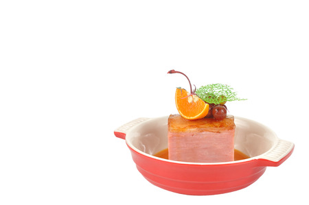 Smoked Honey Ham with orange and cherry fruit in Red bowl