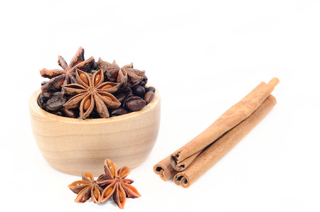 aniseed: Chinese star aniseed Cinnamon and Coffee seeds on white background Stock Photo