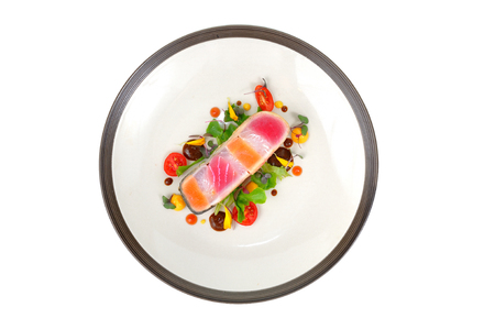 Raw fish steak design lay on white plate, top view. Stock Photo