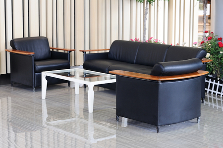 ambient light: Black leather sofa set and white table with ambient light.