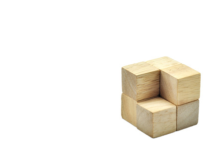 Wooden cubes to be big one and step, business concept team work.