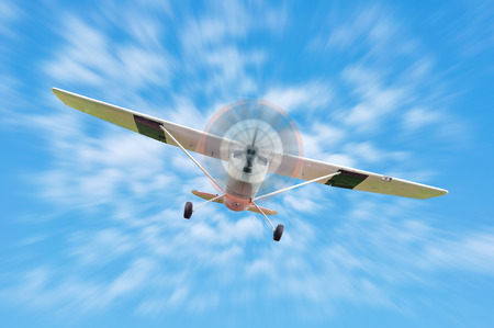 Vintage turboprop airplane flying straight at the camera.