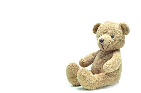 Bruine teddybeerzitting op witte achtergrond. Stockfoto