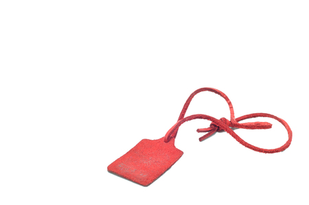 Genuine Leather tag with leather strap on white background. Stock Photo