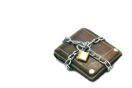 locked: Leather wallet locked for saving, business concept.