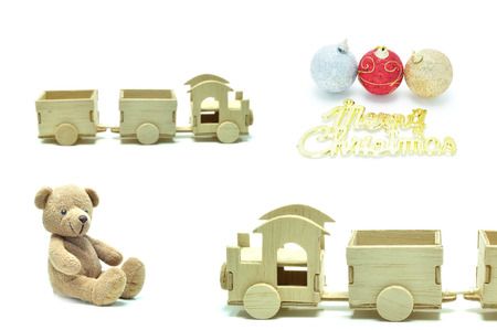 pull along: Wooden train teddy bear and Christmas balls, festival popular gifts on white background.