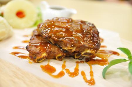 mash: Pork ribs BBQ sweet sauce Western food style with salad and mash potato. Stock Photo