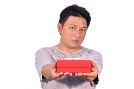 Asian middle man 42 years old with red gift box, human behavior. Stock Photo