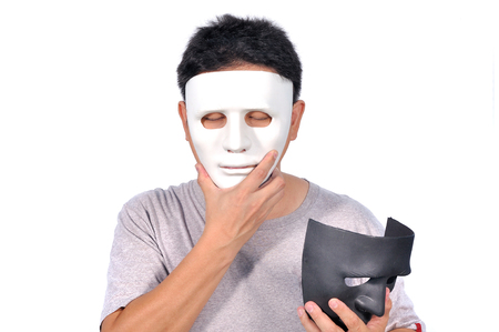 Middle Asian man 42 Years old select white and black mask good side bad side, Human behavior concept.
