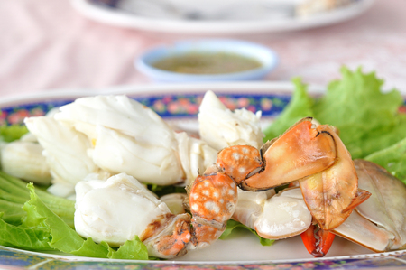 Streamed sculling crab with sauce on plate.