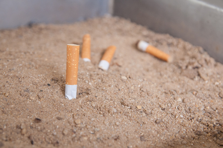 Cigarettes butt on sand tray, World No Tobacco Day 31 Mays Stock Photo
