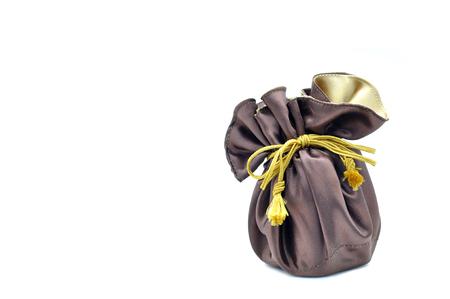 Brown and gold velvet bag on white background. Stock Photo