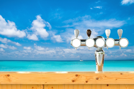 Party, Draft beer dispenser and wooden counter on beach with blue sky