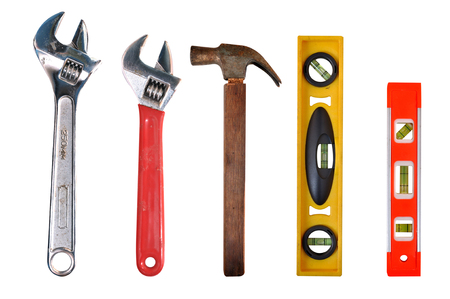 Adjustable Wrench hammer and bubble spirit levels worker tools equipment Stock Photo
