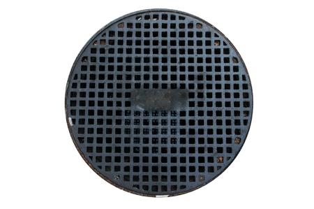 Circular black iron manhole isolated on white background.