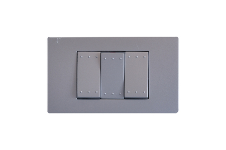 rectangle button: Gray electric switch outlet on white background. Stock Photo