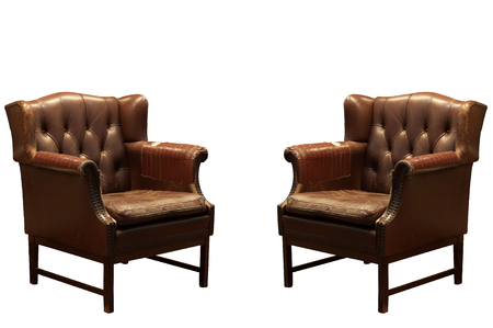 Damage and old brown leather sofa isolated, clipping path included.