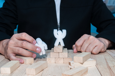 Unidentified business man planning and working with model for business strategy concept. Stock Photo