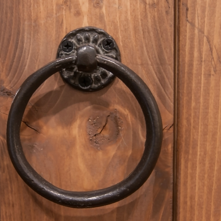 Antique and old iron cycle door knocker.