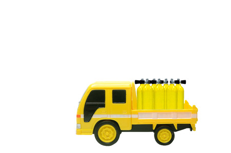 Miniature yellow truck contain yellow oxygen tanks, clipping path included.