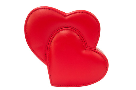 Double red leather heart isolated with clipping path. Lover valentine season concept.