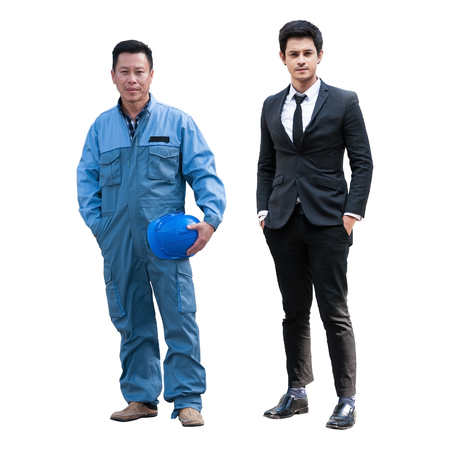 Portrait senior Asian foreman in blue uniform holding blue safety helmet standing next to young Asian business man in black formal suit isolated on white, clipping path included.