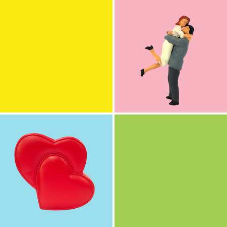 Selective focus miniature lover hugging happy in love, and big red hearts happy in love.  Minimal pastel color conception. 版權商用圖片