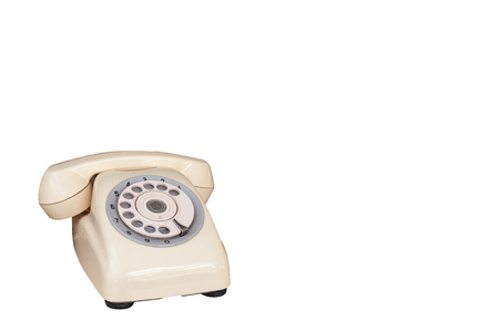 Antique and vintage telephone cream color without wire isolated on white background,  classic home telephone. Reklamní fotografie