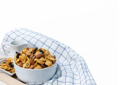 Cornflakes and cereal breakfast, Almond, raisin sultana, mixing to healthy food.