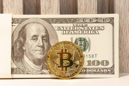 Gold bitcoin crypto currency dollar american banknote for payment disburse debt and investment, currency financial concept. 写真素材 - 130039688